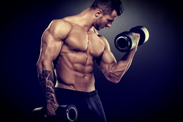 Guy With Man-Boobs Curling Dumbells